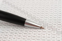 Black ballpoint pen is a cell digital table Stock Image