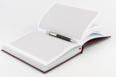 Black ballpoint pen in the center of diary Stock Images
