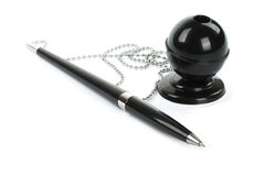 Black ballpoint pen with chain and stand Stock Images