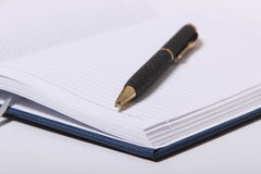 Black ballpoint pen lying on a notebook Royalty Free Stock Images