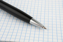 Black ballpoint pen on notebook sheet Royalty Free Stock Photos