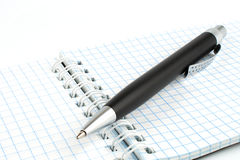 Black ballpoint pen on a notepad with spring Royalty Free Stock Image