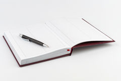 Black ballpoint pen on an open diary Royalty Free Stock Images