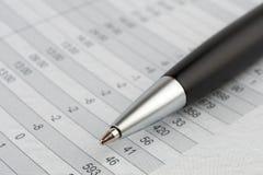 Black ballpoint pen on a sheet. Of figures Stock Image