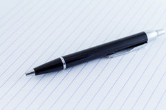 Black Ballpoint Writing Pen ion Lines Writing Paper Royalty Free Stock Image