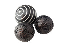 Black balls. Three black balls against a plain background Stock Photography