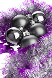Black balls and lilac tinsel Royalty Free Stock Image
