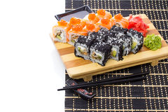Black bamboo mat with sushi isolated on white background Stock Photography