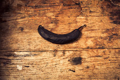 Black banana on a wooden table Stock Photo