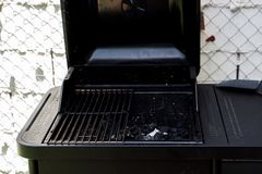 Black barbecue in the backyard of a house royalty free stock photography