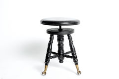 A black barroque style music bench stock photos