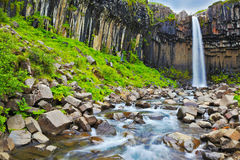 Black basalt columns frame the water jet Stock Photo