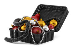 Black basket with christmas decorations isolated on white Royalty Free Stock Images