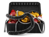 Black basket with christmas decorations  on white Stock Photo