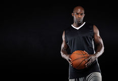Black basketball player with ball Stock Photo