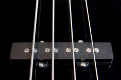 Black bass guitar pickup with strained strings. Black clear jazz rock bass guitar pickup with strained strings Stock Images