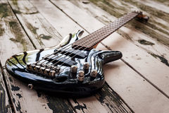 Black bass guitar on a wooden background Stock Photography