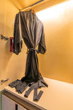 Black Bathrobe. Hang in wardrobe royalty free stock photography