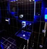 Black bathroom with blue backlight Stock Photos