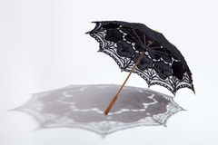 Black Battenburg lace parasol and shadow Stock Photos