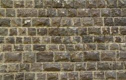Black Bazalt background. Black Bazalt stone (Embedded stones) wall background Stock Photo