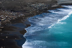 Black beach Stock Images