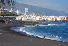 Black beach. At Puerto Cruz, Spain Royalty Free Stock Photos