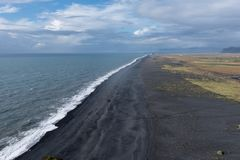 Black sands from the cliff. Black beach, as seen from Dyrholaey royalty free stock photos