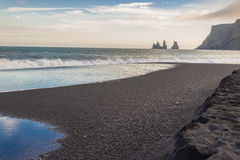 Black beach in background Dyrholaey - Vik, Iceland Royalty Free Stock Images