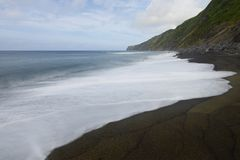 Black Beach, Baia da Ribeira das Cabras, Faial, Azores, Portugal. Black Beach in the Baia da Ribeira das Cabras, Faial, Azores, Portugal Stock Photo