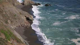 Black beach on Pacific stock video