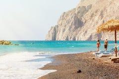 Black beach. Beach with black sand on santorini island Royalty Free Stock Photo