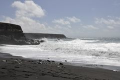 Black beach and surf on Fuerteventura Royalty Free Stock Images