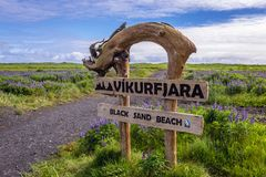 Black beach in Vik. Sign of the beach in Vik town in Iceland royalty free stock images