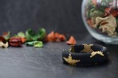 Black beaded bracelet with golden stars Stock Image
