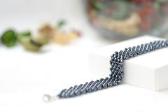 Black beaded bracelet hematite color Stock Image