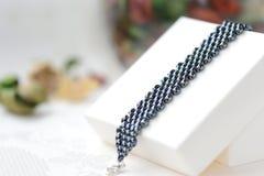 Black beaded bracelet hematite color Royalty Free Stock Image