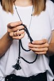 Black beads bracelet in girl hand. Can be used as fashion accessories, also as praying beads, for counting prayers or stock photo