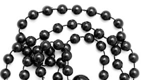 Black beads on a white background Royalty Free Stock Photography