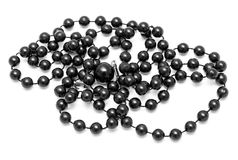Black beads on a white background Royalty Free Stock Photos