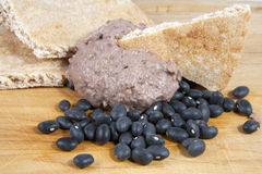 Black Bean Hummus. With pita bread and black beans on wooden cutting board Stock Image