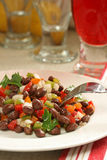 Black Bean and Pepper Salsa. Black bean and pepper salad with glass of red soda Stock Photos