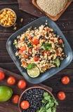 Black bean quinoa salad above stock images