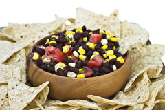 Black bean salad. With corn chips isolated on white. Clipping path included Stock Photos