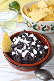 Black bean salsa. With nachos and cheese royalty free stock photo