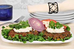 Black bean vegetarian burgers with a goat cheese topping. Stock Images
