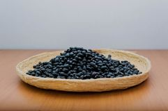 Black beans in a basket royalty free stock photography