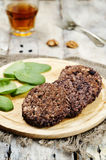 Black beans brown rice walnut oat burgers with spinach Royalty Free Stock Photo