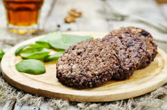 Black beans brown rice walnut oat burgers with spinach. Toning. selective focus Royalty Free Stock Image