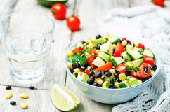 Black beans corn avocado cucumber tomato salad Royalty Free Stock Images